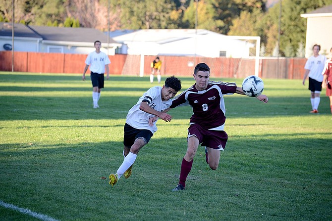 Senior striker/captain Salvador Ramirez (white jersey), fights with a Damascus defender for control of the ball.