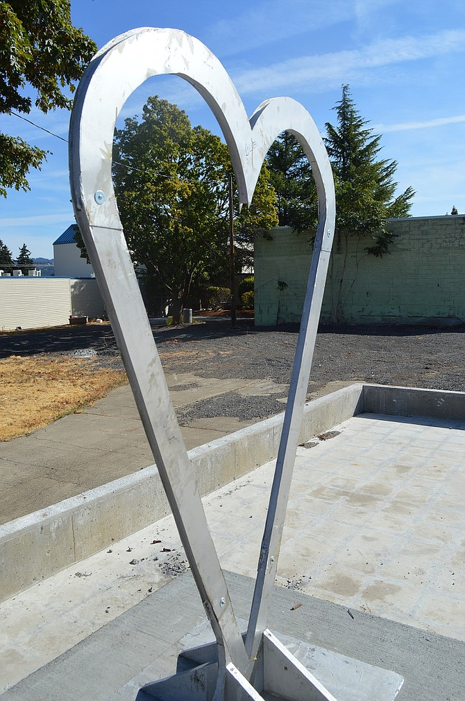 Stainless Heart, Paul Kunihølm Pauper, a new sculpture at a new location, on the Heights at Providence open space at 12th and June streets. sponsored by Providence Memorial Hospital.