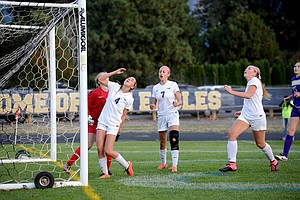 SAVANNAH BRENTLINGER (No. 4) reacts with teammates Kassidy Davidson (No. 7) and Jade Schumacher after missing one of HRV's numerous scoring chances Wednesday night.