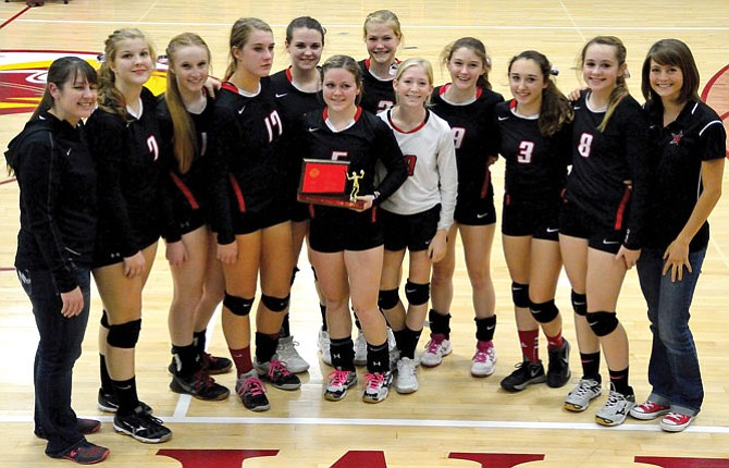 MEMBERS OF THE Dufur volleyball team display their second-place trophy after Saturday's Big Sky District Tournament in The Dalles. Coming off a five-game loss against Ione in the finals, the Lady Rangers have now set the tone for making a return trip to Redmond with hopes of earning state championship glory.