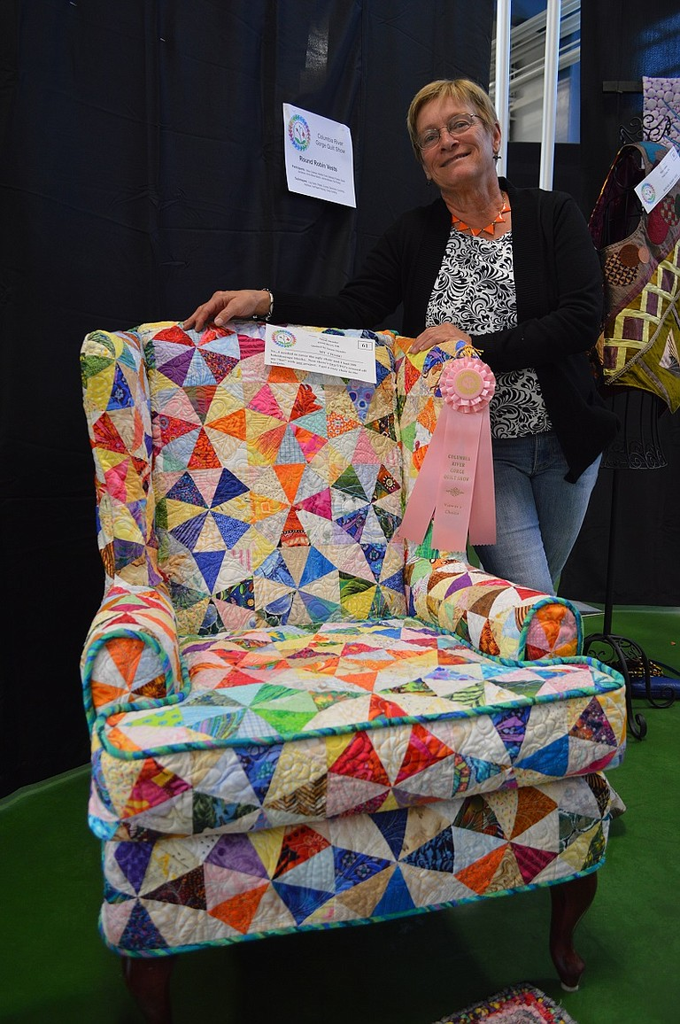 """QUILTED chair by Susan Stender of Hood River won People's Choice honors at the show. """"I took care of two projects at once,"""" Stender said. """"An ugly chair that needed covering and a quilt I had already started."""""""