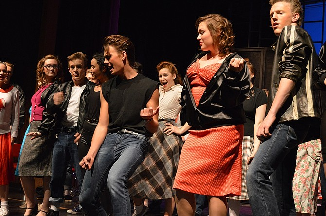 """Frenchy (Atari Gauthier), Doody (Sean Gray), Sandy (Lily Galvez), Danny (Onar Smith), Cha-Cha (Anna Ticknor), Rizzo (Olivia Newcomb) and Kenickie (Jasper Krehbiel) sing """"We Go Together"""" at the conclusion of """"Grease."""""""