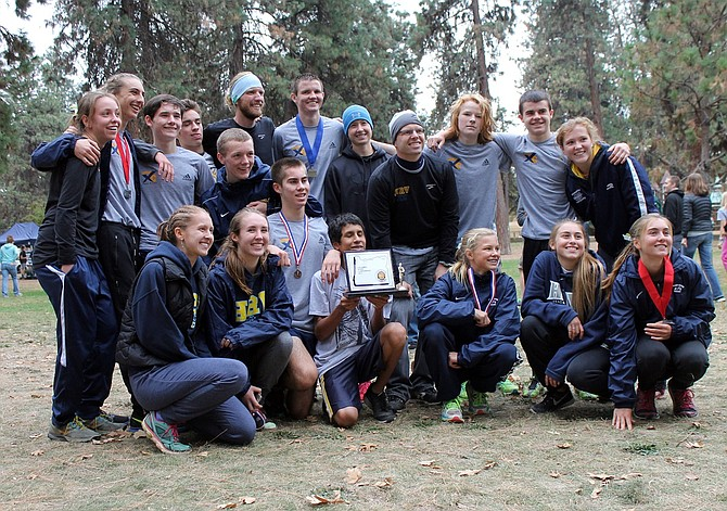 HRV HARRIERS pose with their hardware after competing in the Columbia River Conference Championships Saturday in The Dalles. The boys placed first; the girls second, and are heading to the state meet.