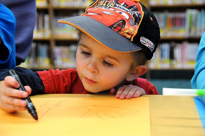 Preschooler Rhett Newson of Grangeville works at a recent library story time.