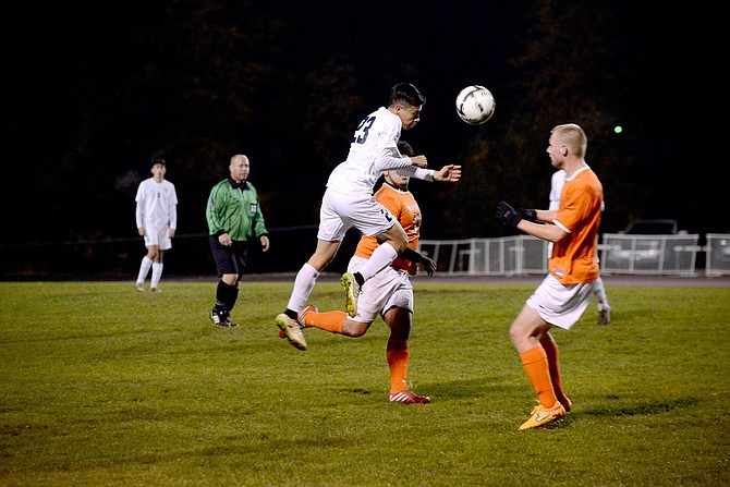 HRV WON a close game against Silverton Tuesday night to advance to the quarterfinals. Jorge Campos (in white) jumps for a header.