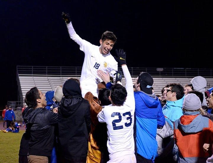 Andres Baeza is lifted into the air by HRV fans who ran onto the field at the conclusion of Tuesday night's game.