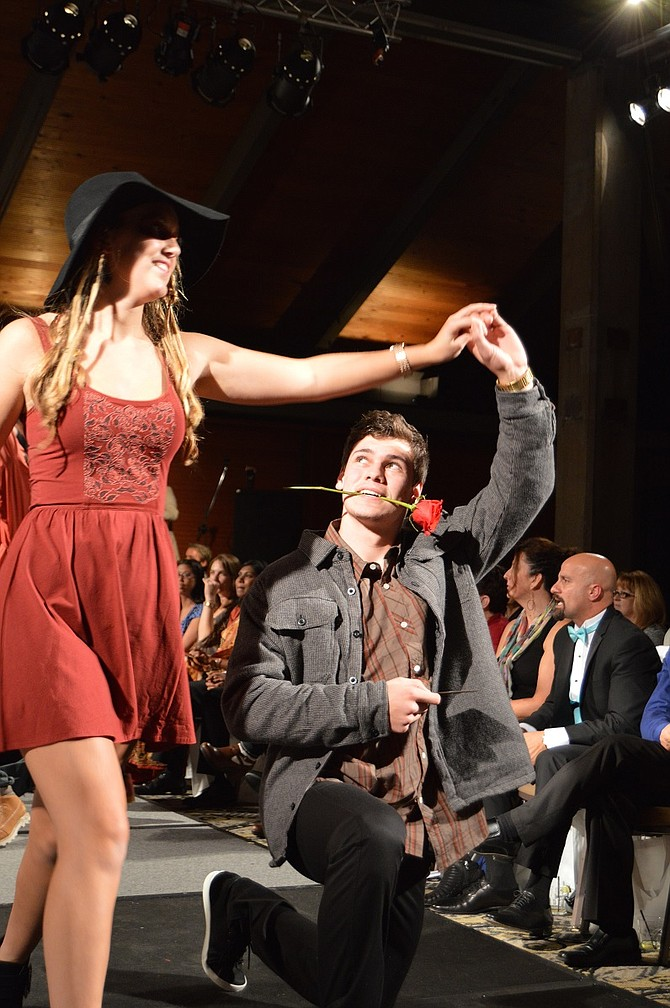 Models from Doug's Sports work the stage — and the audience — at last year's Gala Fashion Show; tickets are on sale now for the Nov. 13, 2015 benefit for The Christmas Project.