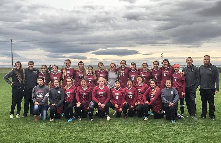 The Okanogan High School soccer team is all smiles after eliminating Warden, 6-2, and reaching the Final 4 of the state 1B/2B tournament.