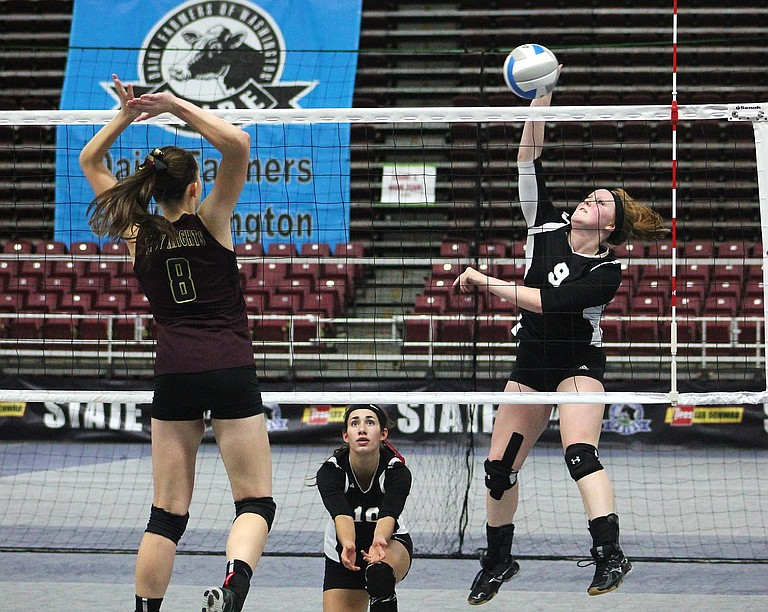 Almira/Coulee-Hartline junior Berlyn Hunt hits the ball past Sunnyside Christian senior Katelyn Banks in the trophy match for fifth and sixth places. Warrior Gabi Isaak backs up Hunt.