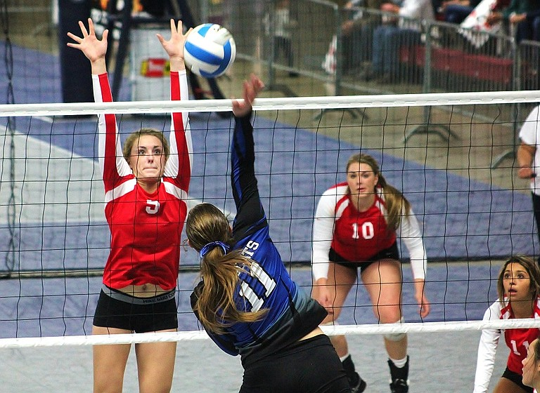 Bee Elliott of Wilbur-Creston tries to put down a spike against the block of Maret Miller of Brewster  during the state 2B tournament Saturday in the Yakima SunDome. Wilbur-Creston eliminated the Bears, 22-25, 26-24, 21-25, 25-23 and 15-10.