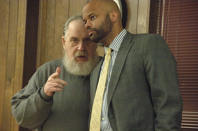 John Jennings, left, confers with his attorney, Myles Johnson, during a break in Jennings' murder trial Tuesday.