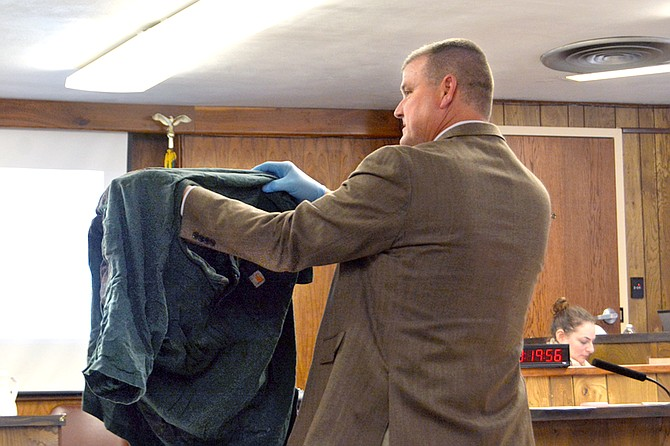 Detective Rob Heyen shows Michael Carrigan's bloodied shirt to the jury on Wednesday.