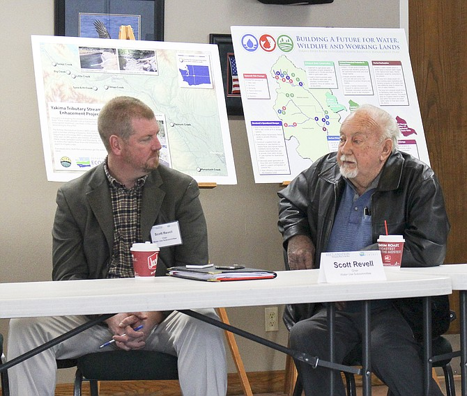 Scott Revell, left, and Ron Van Gundy of the Roza Irrigation District participate in a roundtable discussion on a water plan for the Yakima basin.