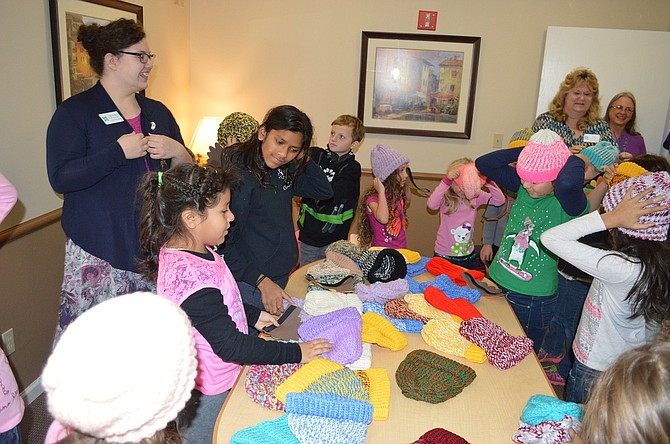 Mid-Columbia Adventist School students select new hats, courtesy of Parkhurst staff and residents.