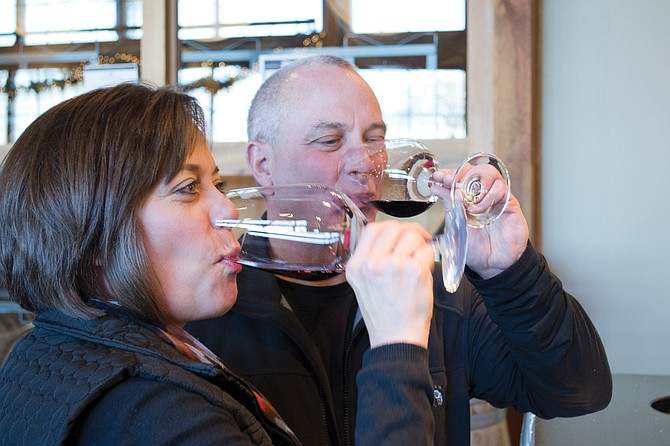 """Patty and Bryan Wetz sample a """"bombshell"""" vintage at Airfield Estates in Prosser during Thanksgiving in Wine Country Weekend. The event allows people to try a variety of local wines."""