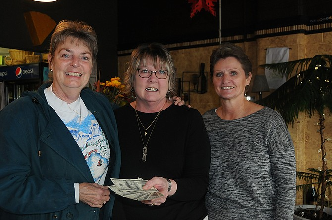 (L-R) Melinda Hall, Sue Kutner and Nancy Asker. The amount left in the Okubberfest fund, pictured here, was $540.