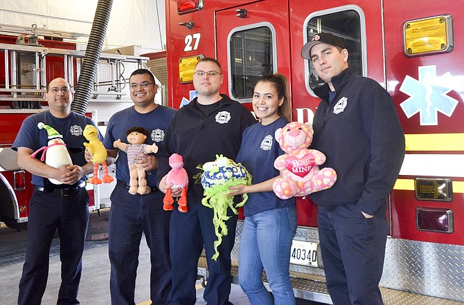 Firefighters adopt families for Christmas | Daily Sun News