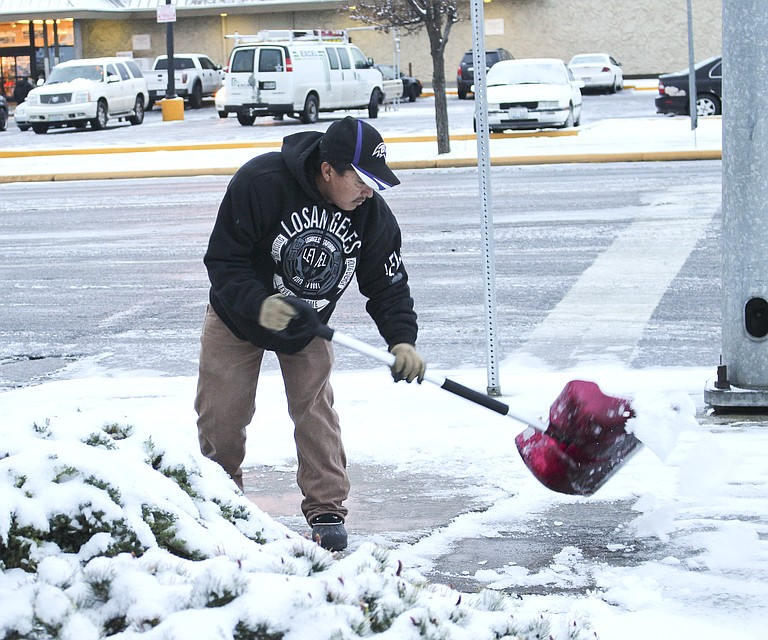 Braving ice streets this morning, Jorge Cruz removes ice and snow from sidewalks in the 600 block of South Sixth Street in Sunnyside. The forecast calls for overnight freezing temperatures. The Lower Valley can expect another winter storm tomorrow.