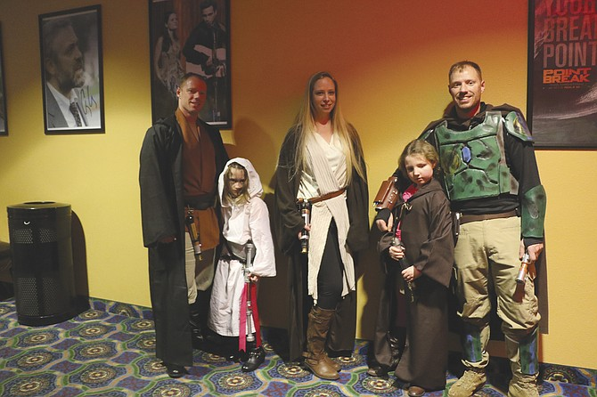 "John Thoma, Cadence Thoma, Christine Cottey, Abby Thoma and Geoff Thoma were a few of the many Star Wars fans attending the premier of ""Star Wars: The Force Awakens"" on Thursday at Independence Cinema."