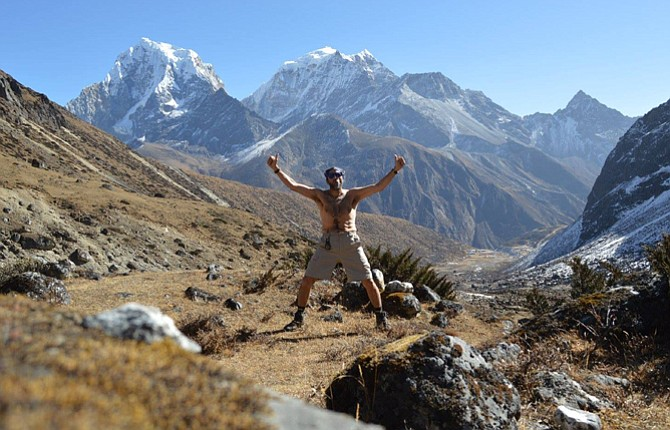 Darryl Houghtelling poses against a backdrop of the Himalayans on a rest day as he trains for the Everest Marathon in Nepal. Houghtelling finished the race, despite losing his way on the coures, which winds down the mountain. 	Contributed photo