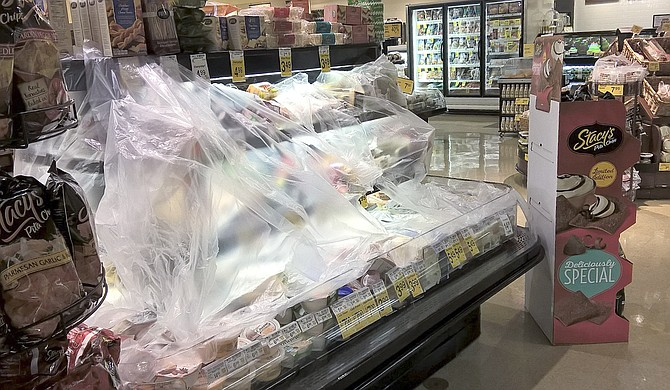 Food displays are covered with plastic at Sunnyside's Safeway to insulate them during a power outage yesterday.