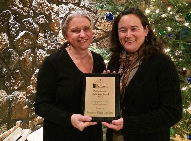Jeanette Kreft-Logsdon, left, accepts her award from NDI director Janet Hamada.