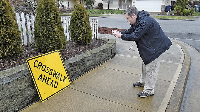 Jason Kistler, Independence IT manager, takes a photo of a sign that blew down in the last wind storm using the IndyWorks app. The sign was fixed about 24 hours later.