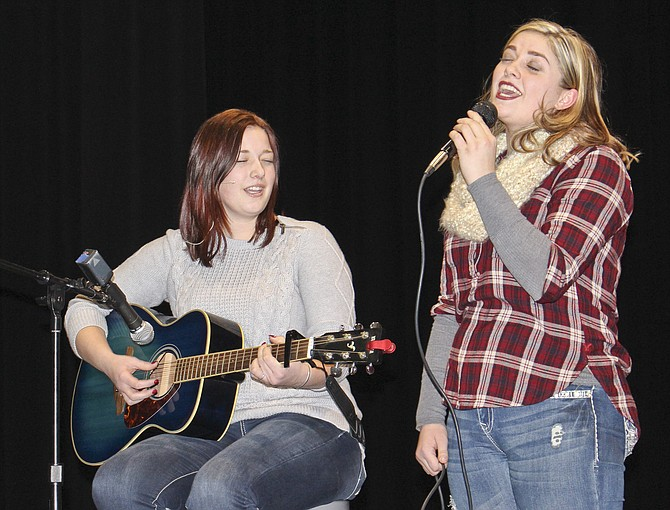 Sister-act Hannah and Kayla Bos, left to right, pour their hearts out in song during last night's Sunnyside High School Hospice Talent Show rehearsals. The Bos sisters will be among more than 10 acts to showcase their entertainment talents at the 16th annual fundraiser for Lower Valley Heartlinks Hospice and Palliative Care. The talent show is 7 p.m. Friday at the high school auditorium, 1801 E. Edison Ave.