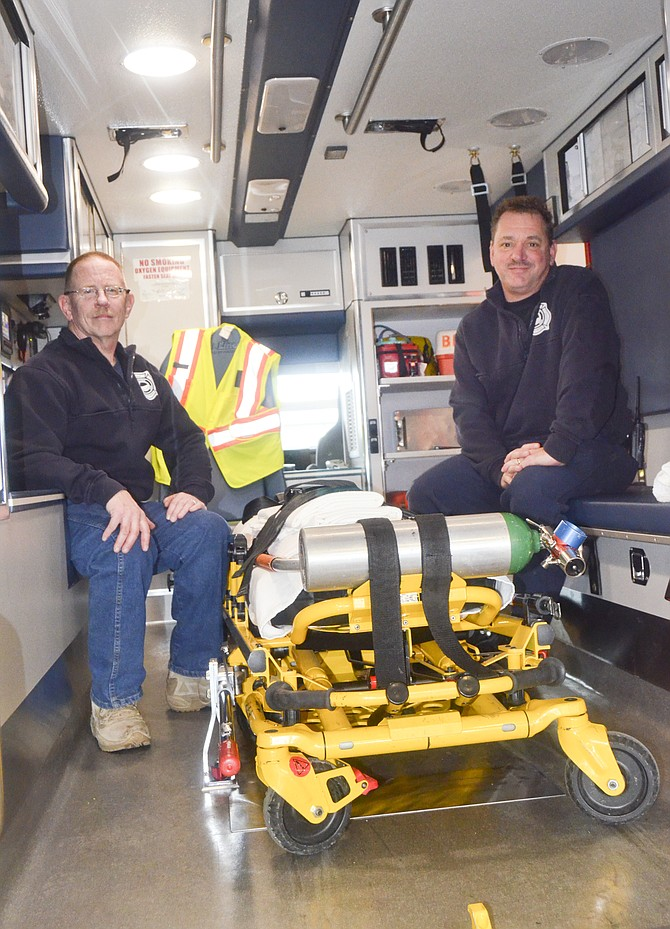 Gregg Hutchinson and Dennis Blumer, the first paramedics Sunnyside hired in 1996, sit inside the city's newest ambulance.