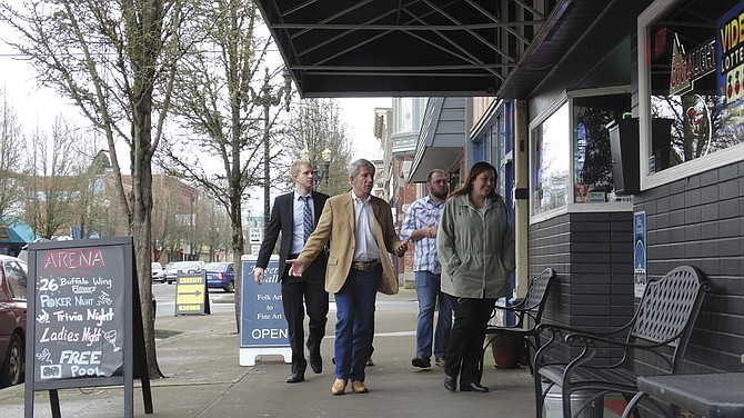Congressman Kurt Schrader (Fifth District), takes a walking tour of downtown Independence with Monmouth-Independence Chamber Director Jean Love on Thursday. The tour included a stop at the Arena Sports Bar & Grill.