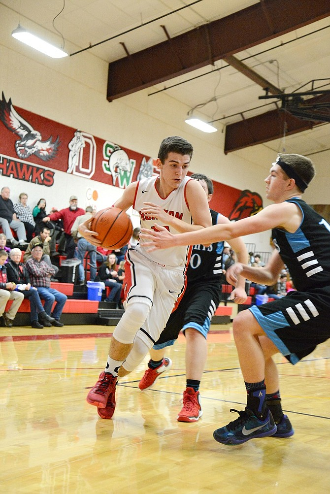 Horizon played Condon/Wheeler Friday night in Hood River, with the boys winning 56-43 and the girls losing 55-44. Above, Ethan Evans drives to the basket (white jersey).