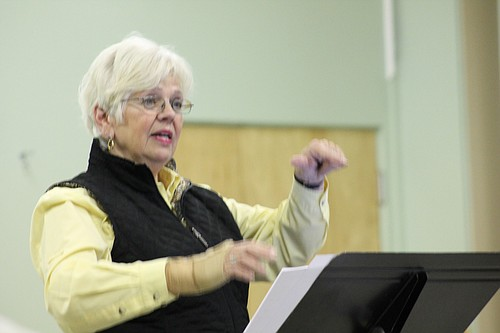 Judy Beckman leads the vocal workshop class through breathing control exercises.