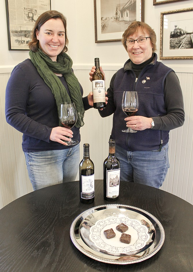 In anticipation of Red Wine and Chocolate weekend, Feb. 13-15, Côte Bonneville winemaker Kerry Shiels and her mother, Kathy Shiels sample a taste of the winery's award winning wines. The second weekend in February also marks the first anniversary of the tasting room's opening on East Edison Ave.
