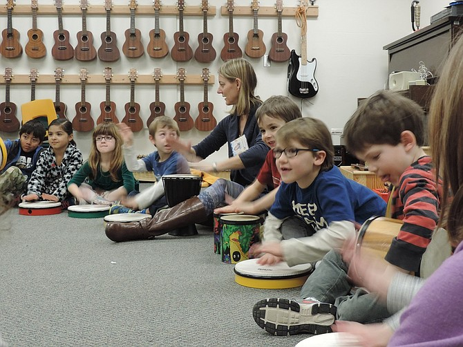 MUSIC room at May Street Elementary heats up fast, especially when students are busy drumming. Jennifer Harty leads kindergarteners in rhythm exercises Monday in a room that the building's aged HVAC system no longer properly cools. Replacement of May Street School is one of the major elements of the proposed bond levy.
