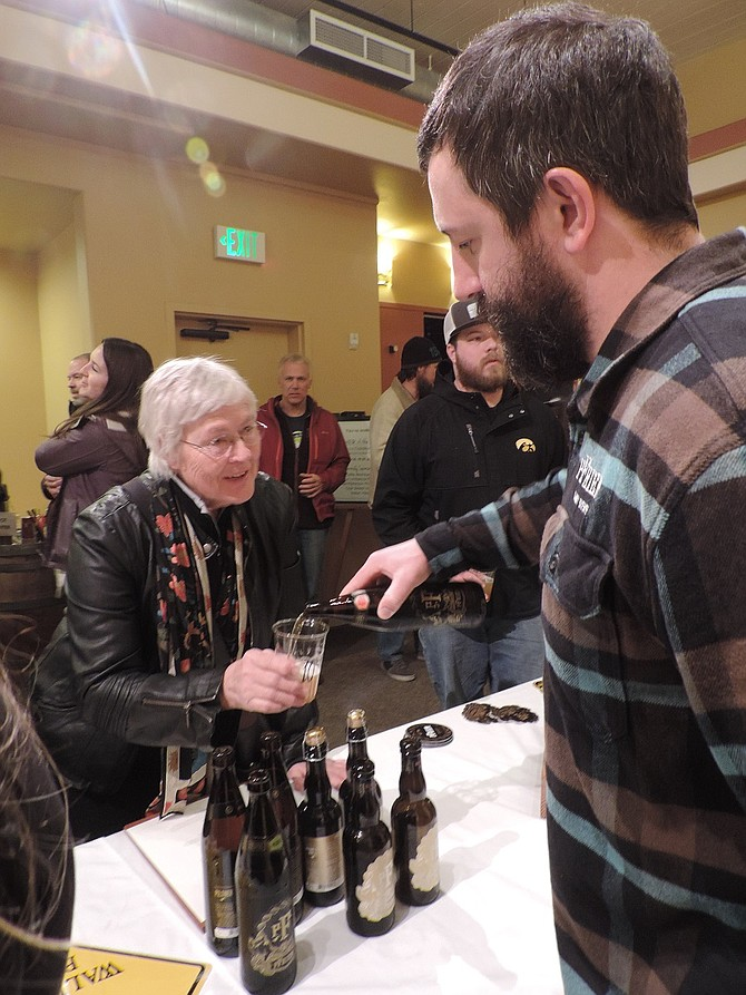 BEER MAKERS of the Gorge, including Josh Pfriem, pouring for Mimi Macht, share their wares Feb. 3 at the Sense of Place lecture. Pfriem has announced plans to expand to the entire 20,000 square-foot Halyard building on the waterfront, making it the second largest brewery in Hood River, after Full Sail.