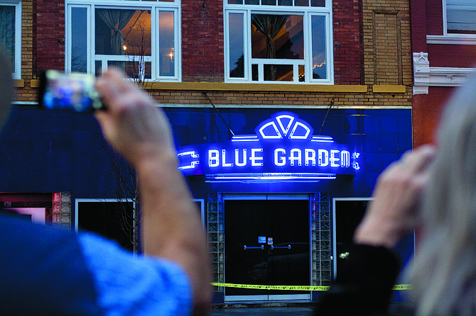 A crowd gathered in downtown to see  the relighting of the Blue Garden sign for the first time in decades in February. The project took a break later in the year, but still in the works for owner Bob Collins.