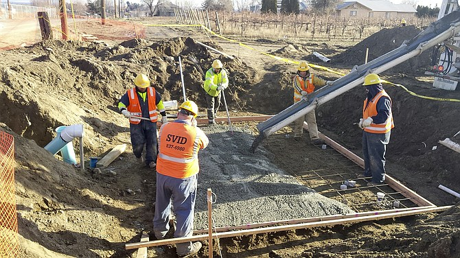 Sunnyside Valley Irrigation District workers pour cement for a vault south of Gurley Road on lateral 23.08.