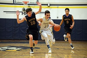 NOAH NOTEBOOM, who led HRV with 19 points, muscles past Hermiston's Austin Naillon during Friday's game in Hood River.