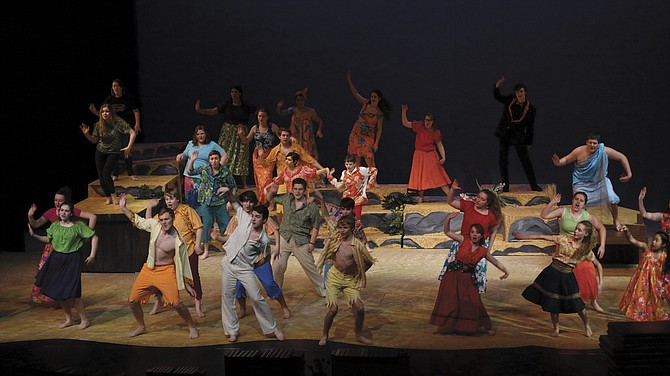 """The cast of """"Once on this Island"""" dances together in the opening number. The musical is packed full of lively musical numbers and dances, and opens Friday at 7:30 p.m."""