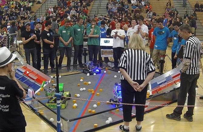 ROBOTICS teams from HRVHS go head-to-head during the finals. Occam's Razor are Blake Winner, left, Jake Kenney, and Will Ferrick; next to them is Men in Green, from left, Joey Slover, Michael McAllister and Luke Serra.