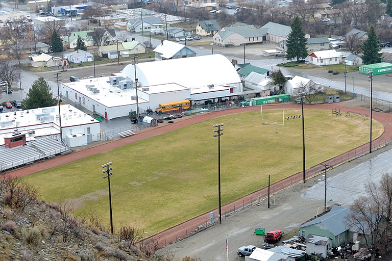 Okanogan school officials propose an all-weather artificial turf surface for sports field, rubberized track.