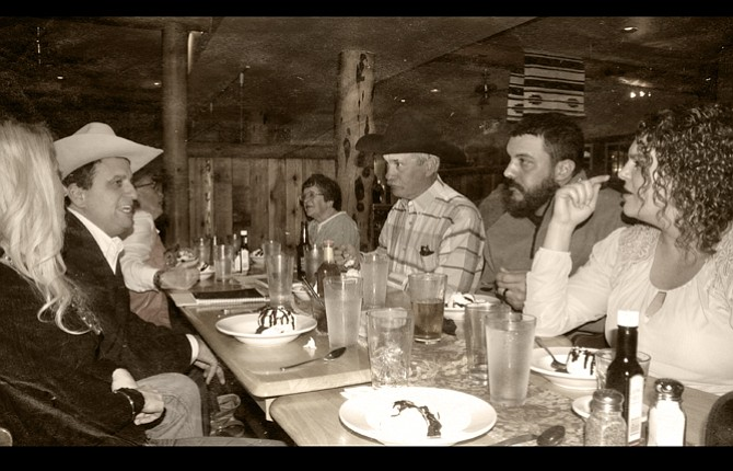 Jerome Rosa, center left, visits with members of the North Central Livestock Association at its annual banquet and business meeting Saturday in Maupin. Rosa was the keynote speaker for the event and updated the audience on the status of a wolf bill in Salem, as well as other political issues affecting the agricultural industry.