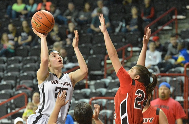 Gabi Isaak of Almira/Coulee-Hartline goes up for a shot against Tulalip Heritage in a loser-out state game Friday at the Spokane Arena. ACH won, 64-43, and will play at 9:30 a.m. Saturday for fourth- for sixth-place.