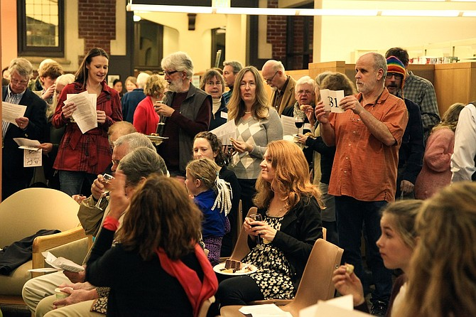 Live and silent auctions will be part of the March 12 Feast of Words event, to raise money for the library's Children's Section.