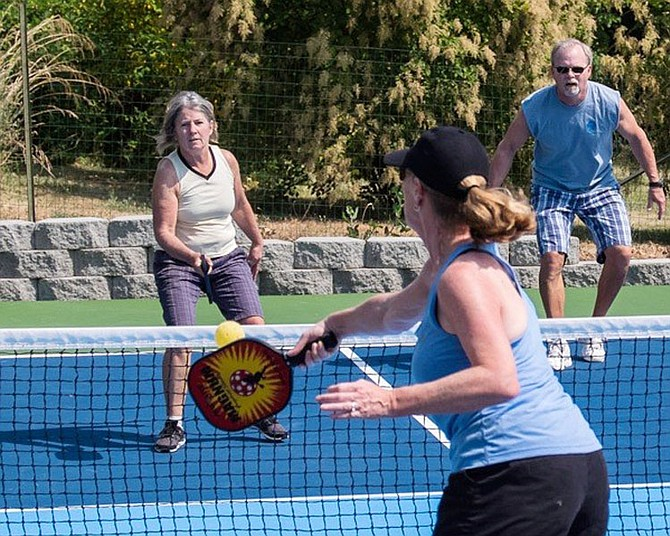 PICKLEBALL PLAYERS Sarah Plotkin, Laney Gale, and Mark Mazeski (left to right) enjoy a game under the sun.