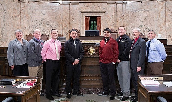The Prosser High School football team joins Reps. Maureen Walsh and Terry Nealey on the House floor Thursday to be recognized under House Bill 4680 for winning the 2015 Class 2A state football championship in December.