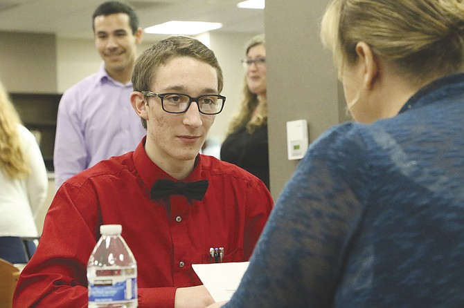 Central junior Matthew Raines takes questions from Michelle Lewis during a mock interview on Friday. The interview was part of a career fair that gave students a chance to work on resume building and get information about different career paths.