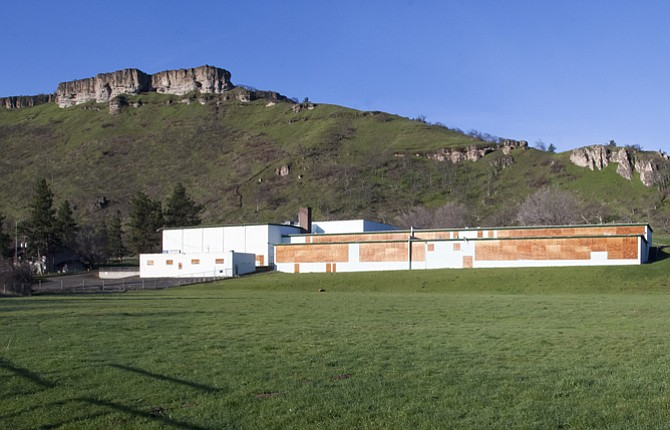 The old Chenowith Middle School gym, located in the left side of the building, above, has been in continuous use since the classroom portion of the school was closed and the windows boarded up. The school district is investigating whether the site could be used for new facilities.