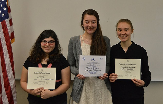 Briana Dunn, Abby Walker and Charley Boonstra were honored by the Celilo Chapter of the Daughters of the American Revolution on Wednesday. Each wrote the winning essay in their respective categories — middle school, Christopher Columbus, and Good Citizenship.