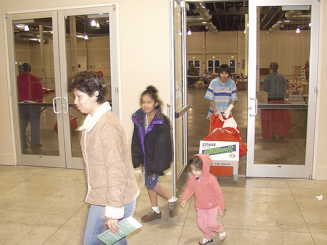 IN THE HEYDAY of Expo Center, the largest public building in the county served many roles, from home of Harvest Fest to serving as distribution center for Hood River Christmas Project, as shown in this 2004 photo of the west atrium entrance.